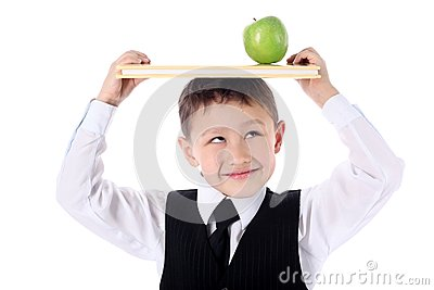 Schoolboy with book and apple