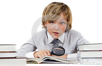 Schoolboy with books and magnifying glass