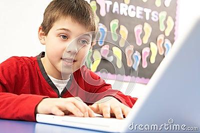 Schoolboy In IT Class Using Computer