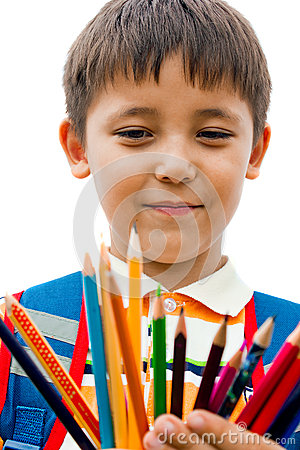 Schoolboy with colored pencils