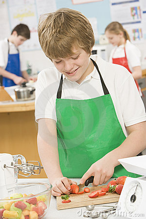 Schoolboy in a cooking class