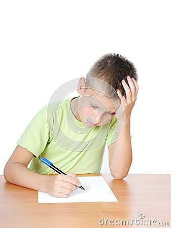 Schoolboy doing bored his homework