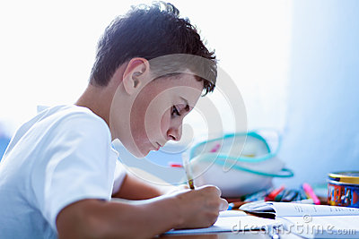 Schoolboy doing homework at home