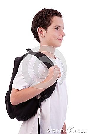 Schoolboy holding backpack