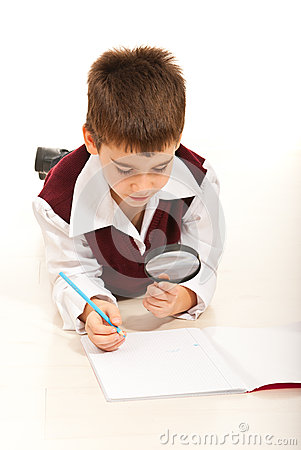 Schoolboy with magnifier home