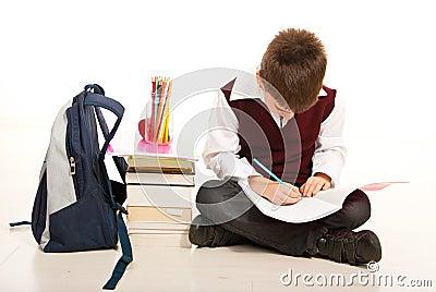Schoolboy making homework