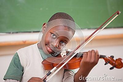 Schoolboy playing the violin