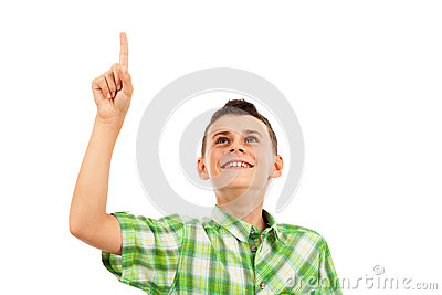 Schoolboy pointing up, isolated on white