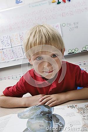 Schoolboy Reading Geography Book