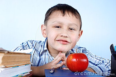 Schoolboy with red apple