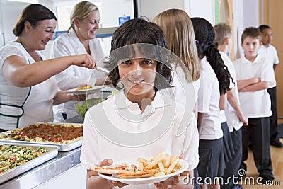 Schoolboy in a school cafeteria