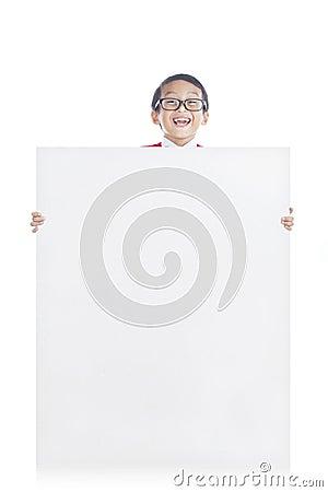 Schoolboy showing copyspace