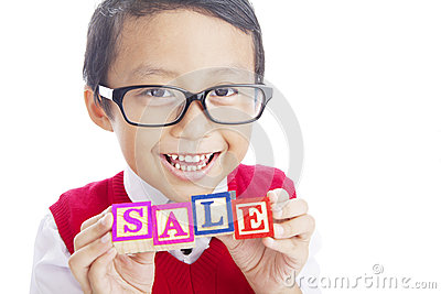 Schoolboy showing SALE word