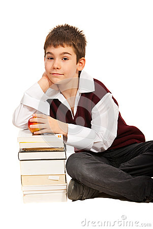 Schoolboy with stack of books