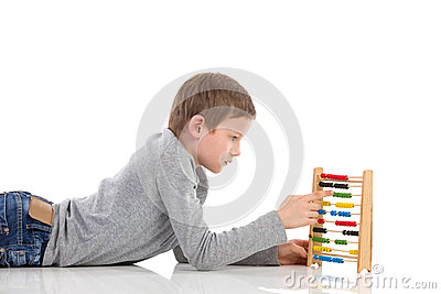 Schoolboy using an abacus Stock Photo