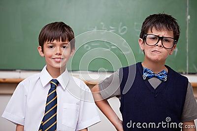 Schoolboys posing in front of a chalkboard