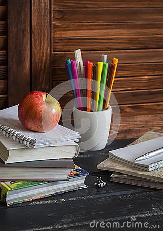 Free Schoolchild And Student Studies Accessories. Books, Notebooks, Notepads, Colored Pencils, Pens, Rulers And A Fresh Red Apple. Home Royalty Free Stock Image - 64561386