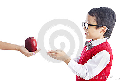 Schoolchild getting apple