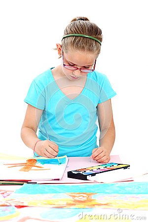 Schoolchild painting with watercolor