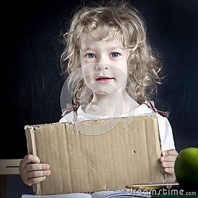 Schoolchild with paper blank