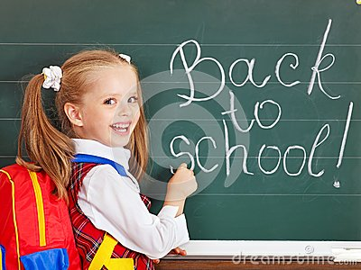 Schoolchild writting on blackboard.