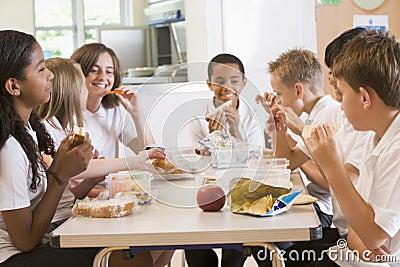 Schoolchildren enjoying their lunch in school