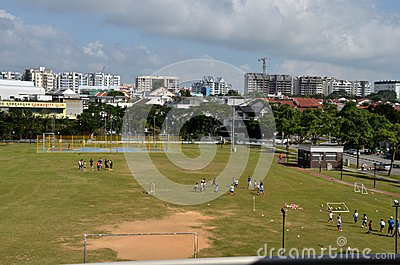 Schoolchildren practicing on playing field Editorial Stock Image