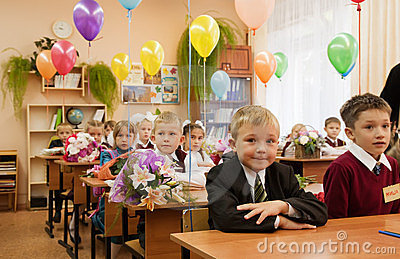 Schoolchildren in their first lesson Editorial Photography