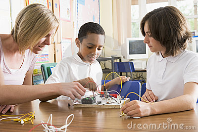 Schoolchildren and their teacher leanring science