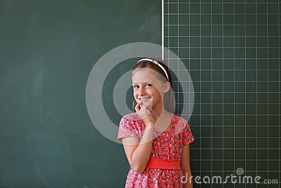 Schoolgirl and blackboard with copy space