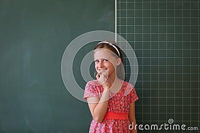 Schoolgirl and blackboard with copy space