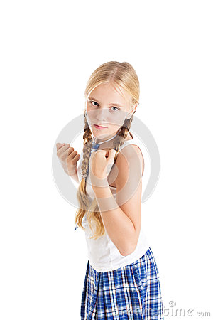 Girl in a fighting stance with clenched fists.