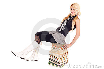 Schoolgirl on book stack