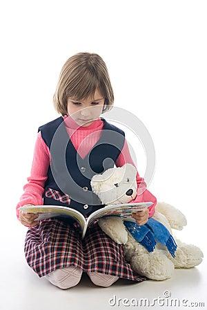 Schoolgirl with book and Teddy Bear