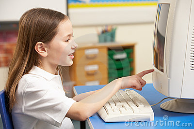Schoolgirl In IT Class Using Computer