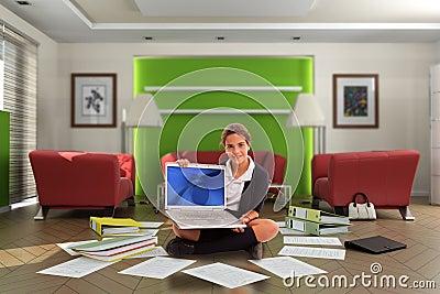 Schoolgirl with computer in messy living room