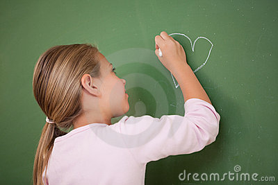 Schoolgirl drawing a heart