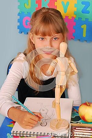 Schoolgirl on drawing lesson