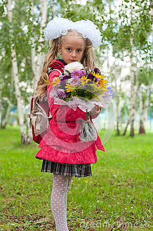 Schoolgirl dressed with a bouquet