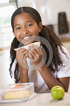 Free Schoolgirl Enjoying Her Lunch In School Cafeteria Stock Images - 6080924