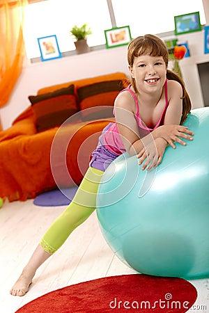 Schoolgirl with exercise ball
