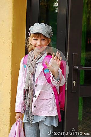 Schoolgirl in the front of school