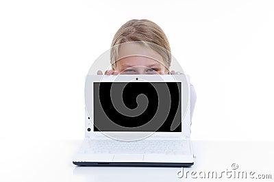 Schoolgirl hiding behind her netbook