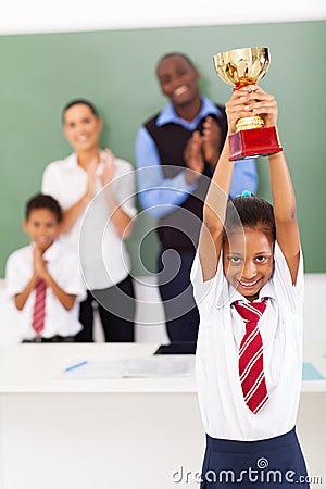 Schoolgirl holding trophy