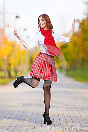 Free Schoolgirl In Red Skirt, White Blouse And Scarf Stock Photo - 50190360