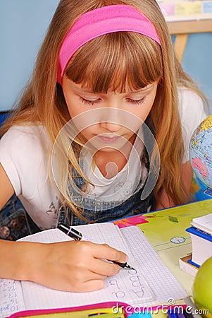 Schoolgirl learning to write