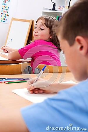 Schoolgirl looking at colleague s test