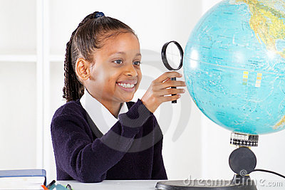 Schoolgirl looking at globe