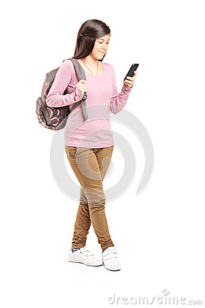 Schoolgirl looking at her cell phone