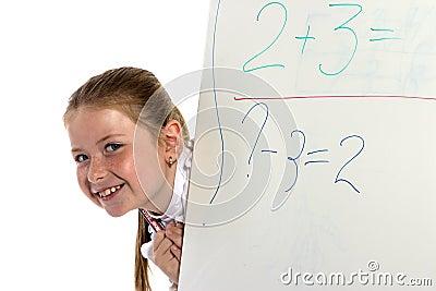 Schoolgirl looks from a board